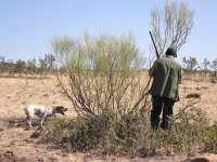 caza en mano